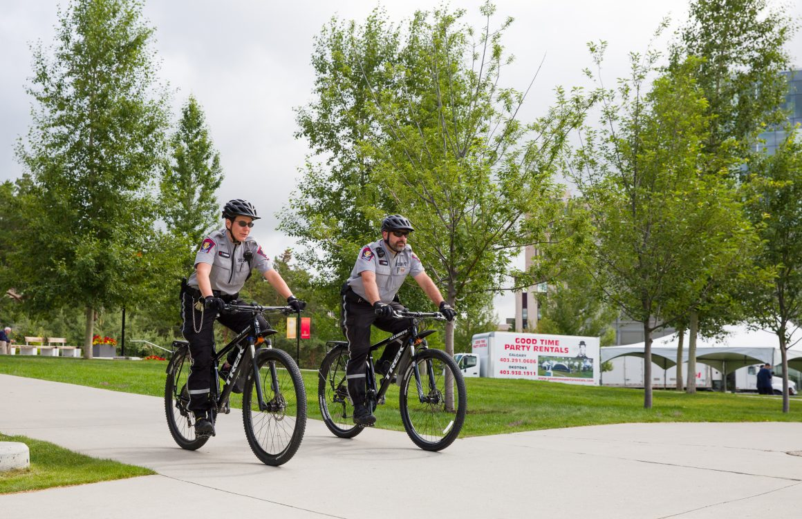Security officers Jean Beaudoin and Tesha Ligren are the first non-police officers to complete instructor training for bike units in Colorado.